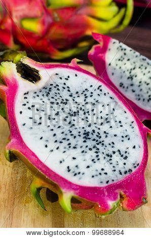 Half White Dragomfruit On Cutting Board