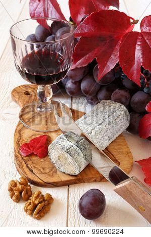 French Blue Cheese, Red Grapes, Scarlet Leaves And Wineglass
