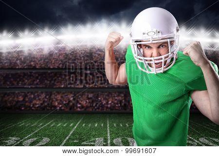 Football Player on green uniform in the stadium