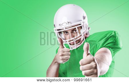 Football Player on green uniform on green background