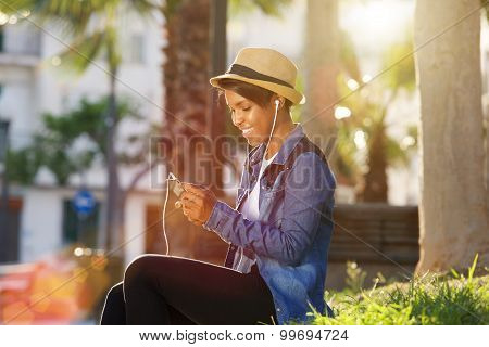 African American Woman Listening To Music On Cell Phone