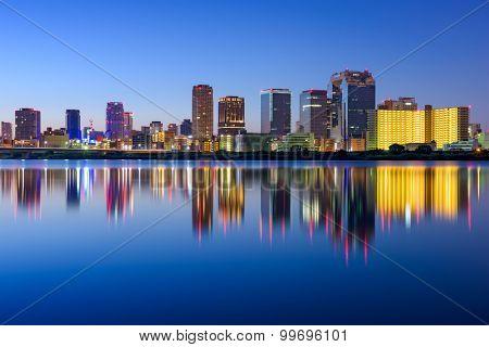 Osaka, Japan skyline on the Yodogawa River.