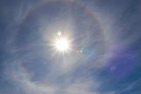 picture of sun rays  - hot sun at zenith with rainbow circle - JPG