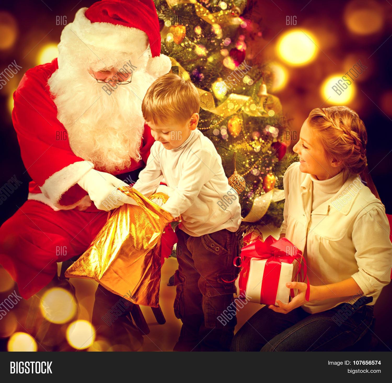 Santa claus giving christmas gifts image photo bigstock