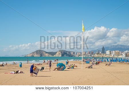 Sunbathers On Benidorm Beach