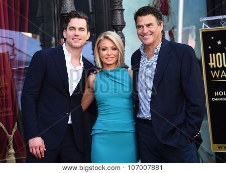 LOS ANGELES - OCT 12:  Matt Bomer, Kelly Ripa & Ted McGinley arrives to the Walk of Fame honors Kelly Ripa on October 12, 2015 in Hollywood, CA.