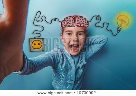 baby girl laughing close up photo makes the charging cord plug w