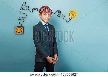 boy dressed businessman is charging cord plug wire igniter charg