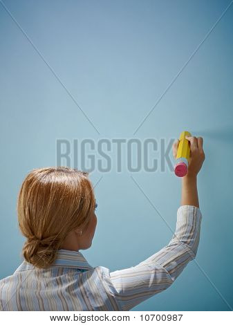 Businesswoman Writing With Big Pencil