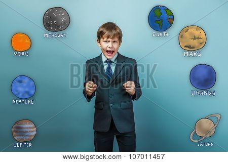 a teenager in a business style suit boy clenched his fists and s