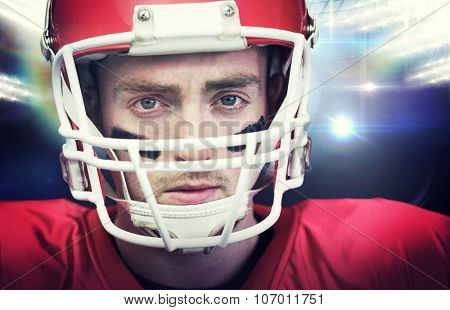 Portrait of focused american football player wearing his helmet against american football arena