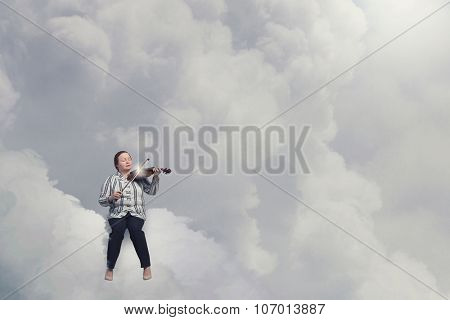 Middle aged stout woman on cloud playing violin