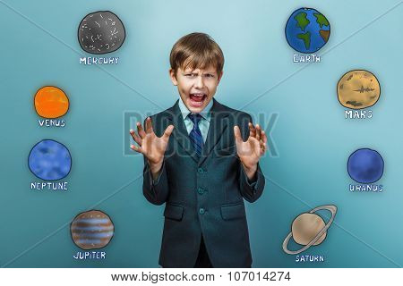 Boy young man in a business suit teenager opened his mouth to sc