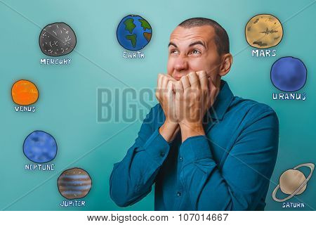 businessman chewing his fingers raised his hands to his mouth an