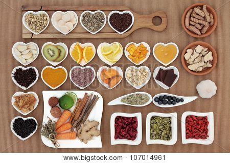 Large health food selection for cold cure remedy with vitamin c supplement capsules and medicinal herbs and spices, high in antioxidants.