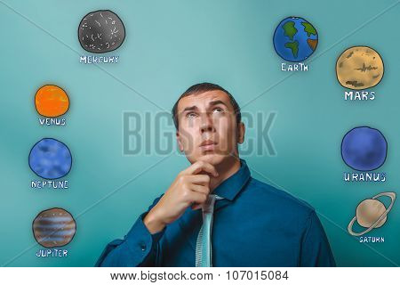 businessman man holds his chin thinking planets of the solar sys