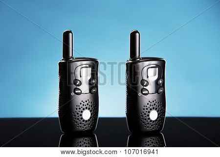 Walkie Talkie Portable Radio Isolated On Blue Background