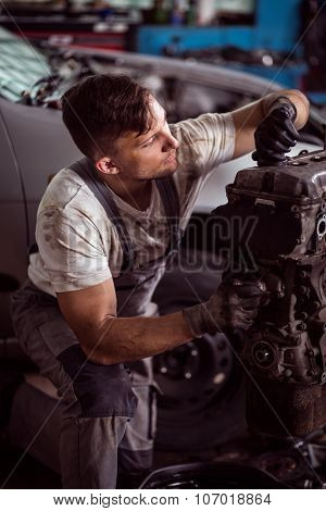 Mechanic Repairing Engine
