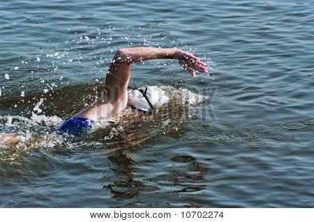 The Girl Sportswoman Floats In Pool Water