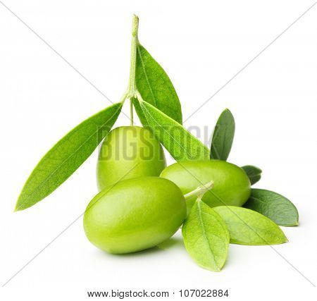 Green olives with leaves isolated on white