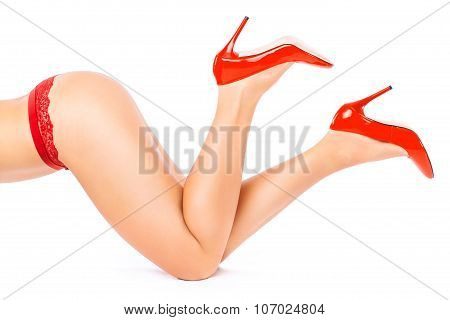 Woman in red shoes and underwear on all fours