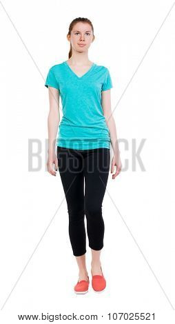 front view of walking woman.   beautiful blonde girl in motion.  backside view of person.  Rear view people collection. Isolated over white background. Sport girl in black tights comes to meet us.