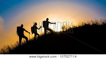 Climbers on grassy hill