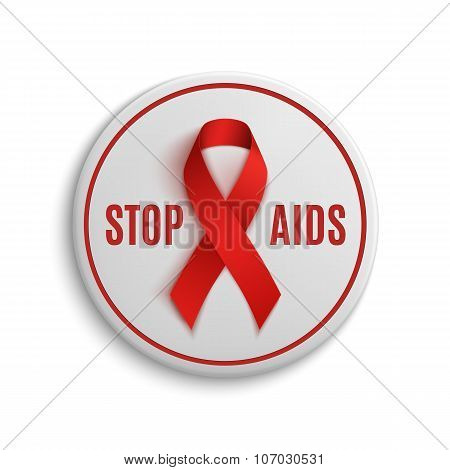 Stop AIDS white badge with red ribbon.