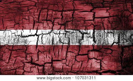 flag of Latvia, Latvian flag painted on cracked ground