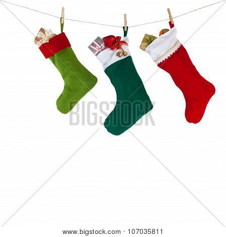 Christmas socks hanging on the rope with clothespins. isolated