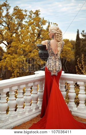 Sexy Back Young Beauty Woman In Mermaid Red Dress. Gorgeous Fashion Blond Girl Model With Long Curly