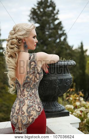 Elegant Healthy Hairstyle. Sexy Lady. Beauty Gorgeous Young Woman In Fashion Luxury Dress  Leaning O