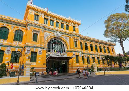 HO CHI MINH, VIETNAM, FEBRUARY 25, 2015 : Large view on the central French colonial style post office with tourists in Ho Chi Minh city (Saigon), Vietnam