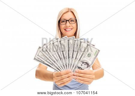 Young blond woman spreading a stack of money and showing it to the camera isolated on white background