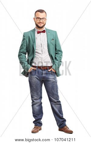 Full length portrait of a young man posing in a green coat and a red bow-tie isolated on white background