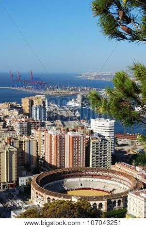 Malaga bullring and coastline.
