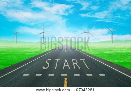 Road Through The Green Field With Sign Start On Asphalt