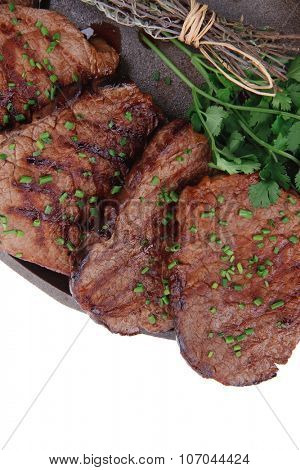fresh ripe grilled beef meat on pan isolated on white background