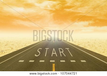 Road Through The Desert With Sign Start On Asphalt At Sunset