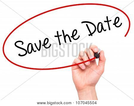 Man Hand writing Save the Date with black marker on visual screen.