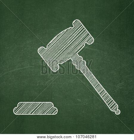 Law concept: Gavel on chalkboard background