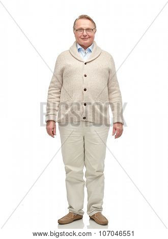 age, fashion and people concept - smiling senior man in cardigan