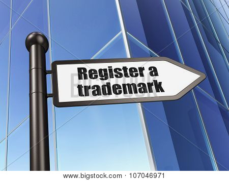 Law concept: sign Register A Trademark on Building background
