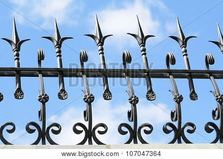 Metal Forged Fence On The Background Of Blue Sky