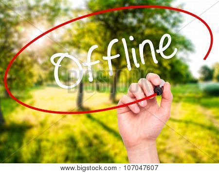Man Hand writing Offline with black marker on visual screen.
