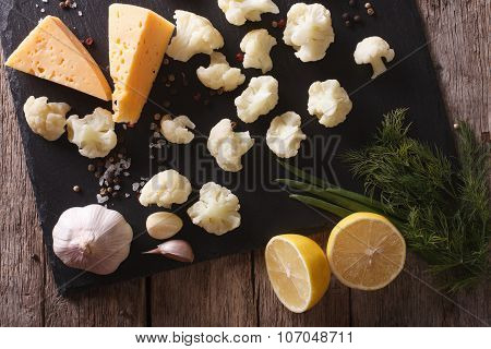 Preparation Of Cauliflower For Baking With Ingredients Horizontal Top View