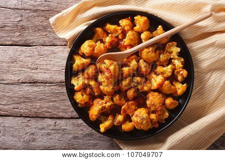 Cauliflower With Tomatoes In Curry. Horizontal Top View