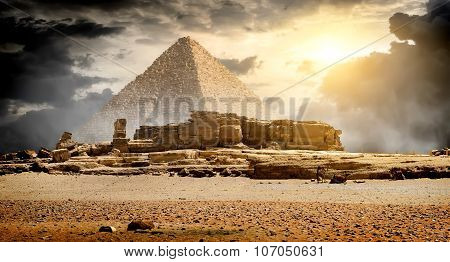 Clouds over pyramid