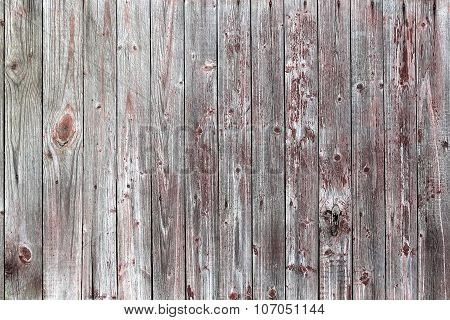 Vintage Wooden Fence From Boards Of Pine With The Noble Gray Tint And Traces Of Red Paint