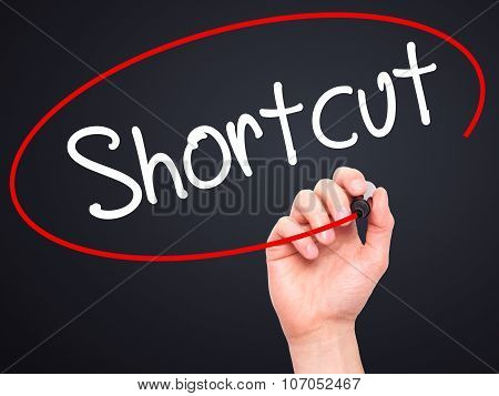 Man Hand writing Shortcut with black marker on visual screen.